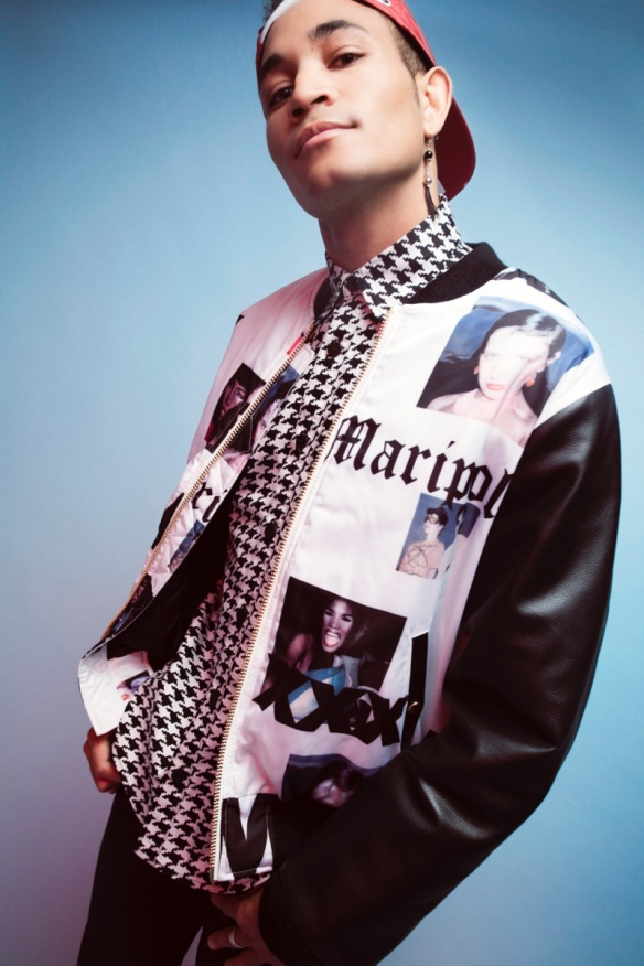 Bryce wears button-up Paulie Gibson, graphic club jacket Joyrich, pants Zara and snapback Urban Outfitters.